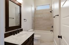 Traditional Full Bathroom with Complex marble counters, High ceiling, Flat panel cabinets, Drop-In Bathtub, Rain Shower Head