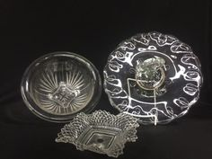 MIXED LOT OF GLASSWARE INCLUDING AN 11 INCH DIAMETER TIDBIT TRAY, A 4.5X9.5 INCH FOOTED BOWL AND A 6X6 INCH DIAMOND POINT PATTERN CANDY BOWL.