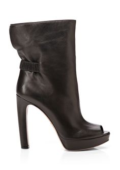"PRADA Peep Toe Ankle Boot • Features ruched elasticized band at heel  • Platform sole  • Slip on style  Material: Leather upper, leather lining and sole Approx. measurements: platform 1"", heel 5"" Origin: Made in Italy Fit: This style fits true to size"
