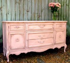 Old pink sideboard. This looks like our green one... Guess who's going to paint it pink...