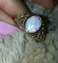 14K gold opal ring    Oh my. I would die if someone got this for me. my two favorite things! <3