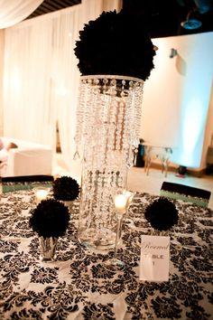 Black flower ball in cylinder vase with jewel chandelier