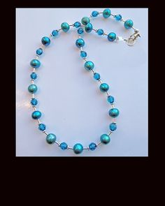 Liquid Sterling Silver with Bright Turquoise Freshwater Pearls & Swarovski Crystals.