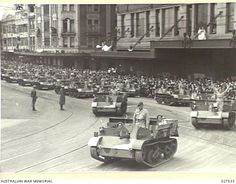A FLEET OF BREN GUN CARRIERS COMING DOWN ELIZABETH STREET. THEY ARE PART OF THE PROCESSION THROUGH THE CITY OF SYDNEY OF A DISPLAY OF AUSTRALIAN-MADE MUNITIONS. NEARLY 400 VEHICLES OF VARIOUS TYPES ...