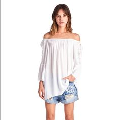 Boho off the shoulder bell sleeve top This beautiful flowy top is great for the spring weather.  It can be worn off the shoulders or not m wearing both ways is absolutely stunning. The material is 95% polyester and 5% rayon.  Goes great with a pair of denim shorts or jeans. April Spirit Tops