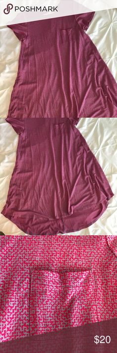"""LuLaRoe Carly Dress- Pink Geo Print LuLaRoe Brand Carly Dress. Size large. This has been worn once and washed on delicate and hung to dry. Measurements: 40"""" overall length (front), 45"""" overall length (back), sleeves- 8"""", bust-42"""". Care instructions- machine wash cold and hang to dry or you will be sad. LuLaRoe Dresses Midi"""