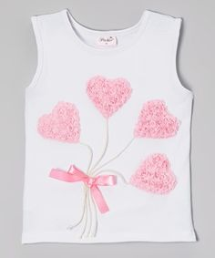 This stretchy tank will accompany cuties from parties to playdates to dance practice—and everywhere in between! Its sweetly ruffled appliqué and classic cut make it the perfect complement to any outfit a little princess could dream up.