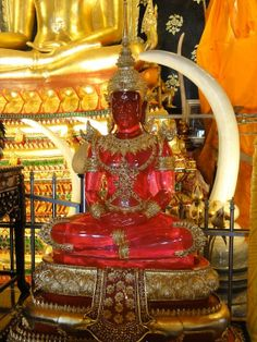 BUDDHA~A red Buddha at Wat Neramit Temple