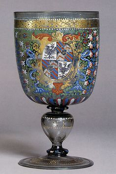 Armorial Goblet c1592.  South Germany or the Tyrol.  Medium: Colorless (strong gray) nonlead glass. Blown, enameled, gilt.