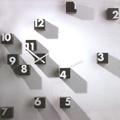 "rnd_time Infinite Wall Clock The most unusual feature of this clock lies in its entirely random application to the wall, hence the name ""rnd_time"", where ""rnd"" is used to indicate the random factor. Each cube is made in nylon plastic, one cube for each hour, another to house the clock hands and battery. 1"