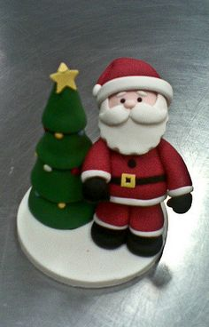 https://flic.kr/p/7yt1gr   Santa and Christmas Tree   Christmas topper made from icing.