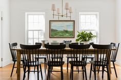 "Love the idea of using a modern Windsor dining chair, but still think it would look too ""busy"" with so many chairs"