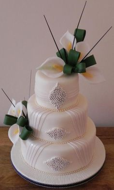 Pleat, lily and jewelled wedding cake