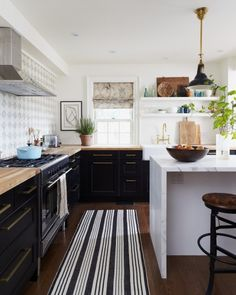 Black cabinets, marble island