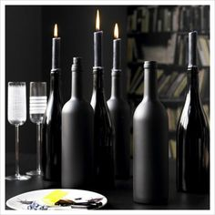 DIY painted wine bottle candle holders. This could be beautiful in pastels too!