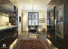 Persian rug, enhanced by floor level indirect lighting, creates a nice contrast to contemporary kitchen (Kelly Hoppen)