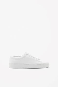 A minimal style, these lace-up sneakers are made from panels of smooth leather with a sporty rubber sole. They are completed with a comfortable cushioned insole.
