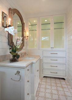 Ship lap, mosaic floor, built-in linen cabinets   Brandon Architects