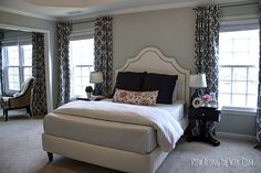 Master bedroom with DIY curtains at www.viewalongtheway.com