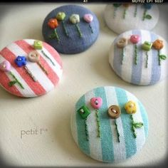 Pretty buttons on to pretty buttons! Textile Jewelry, Embroidery Jewelry, Hand Embroidery Patterns, Fabric Jewelry, Floral Embroidery, Beaded Embroidery, Cross Stitch Embroidery, Embroidery Designs, Cute Crafts