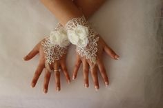 WEDDİNG GLOVES   elegant pearl inlaid ivory on ivory lace wedding dress gloves. French lace wedding gloves ... Soft and delicate Made with love to make your special day a fairytale ...  Each custom-made suitable   french lace used is very delicate and special. Unique and special. Only a custom design you can see my shop. strap attached. use special gloves are quite comfortable. Click the link below for the same lace barefoot sandals https://www.etsy.com/listing/259988051&#...