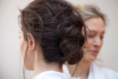 Such a cute looking twisted updo using messy brunette hair.