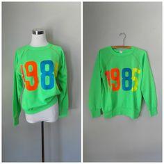 fun #1985 #neon sweatshirt, size M - in the #etsyshop now!  #sweatshirt #jumper #pullover #retro #vintage #vintageshop #vintageseller #roadkillvintage #80s #green #pink #blue #orange #hipster #1980s #80sstyle #fashion #thrifty #thriftstore #love #grunge #hippie #boho