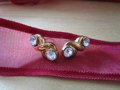 New Listing Started goldtone stud earrings kixx with clear stone either side from Marks and Spencer £1.25