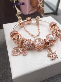 Pandora rose gold bracelet with 11 pcs charms 100% pure 925 sterling silver charms: pure 925 sterling silver ,murano glass *With fine PANDORA jewelry box accessories*. How to choose: 16cm,17cm,18cm,19cm,20cm,21cm,22cm available a)1-4 pcs charms' bracelet,add 2cm to your wrist circle size b)above 4 pcs charms' bracele