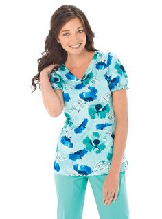 Uniquely youthful and elegant in appeal, this Landau nursing scrub top features a pin tucked faux crossover neckline and empire waist, which gives this top a flattering silhouette.