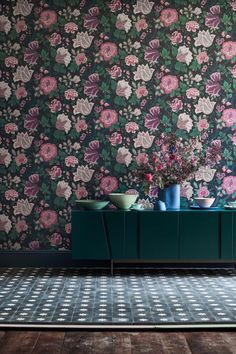 A classic wallpaper print from the Cole & Son archive, skillfully re-coloured to create a rich and lavish trailing floral design depicting summer flowers in full bloom. Shown here in the Mulberry, Purple & Teal on Ink colourway #darkfloralwallpaper