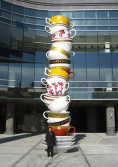 Tea Cup sculpture creates a vibrant, fun element to what would be a bland space.