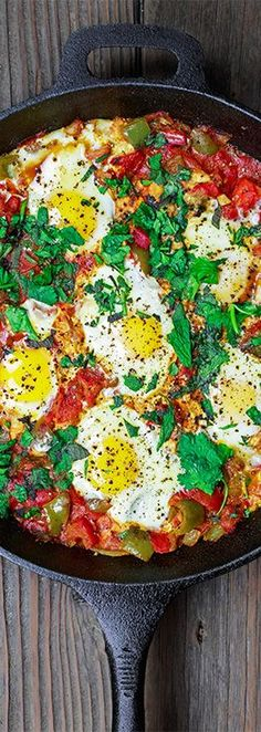 Simple Shakshuka Recipe | The Mediterranean Dish. Shakshuka is a delicious Middle Eastern dish of eggs poached in a spiced, saucy tomato stew. Perfect for breakfast, lunch or dinner! All you need to add is your favorite bread. This is a simple vegetarian recipe that you can make in less than 30 minutes! My family's favorite. And feeds a crowd on a small budget. See the recipe on http://TheMediterraneanDish.com