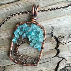 Apatite Gemstone Chip Wire Wrapped Tree of Life Pendant Handcrafted by Ann White. The pendant is medium and hangs 1/3/4 inches from the top of the bail and 1 inch wide. Pendant comes on an Antique Cop