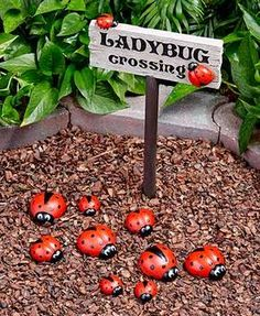 "Create an adorable scene in your yard with this Ladybug Garden Décor. Place the Ladybug Crossing Sign (8""W x 15-1/2""L, including the 3"" ground st"