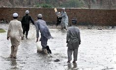 RAWALPINDI: Youngsters play cricket amidst rain on Friday. Heavy downpour in the twin cities turned the weather pleasant.