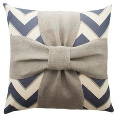 Add a charming touch to your sofa or favorite reading nook with this eye-catching cotton and burlap pillow, featuring a chevron motif and bow accent. Handmad...