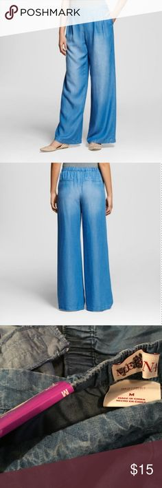 Merona Tencel Wide Leg Pant These are still available on target.com! From website: Trend up with the Women's Tencel Wide Leg Pant by Merona. These mid rise trendy pants have a plain waistline with elastic in back. Not quite as voluminous as palazzo pants, these easygoing trousers have subtle darts in front and two welt pockets in back. These don't have the price tag, only the tag on the back. There is a dark mark on the brand tag, doesn't affect wear. No trades. Merona Pants Wide Leg