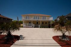 Renovations galore make this a fabulous beach house - including everything you need for a wonderful vacation, INCLUDING YOUR OWN PUTTING GREEN! Take a quick walk to the beach or play in the beautiful ...
