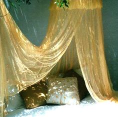 Hand dyed mosquito nets, for a sense of fantasy - decorated with sequins, beads, bells, and diamantes...