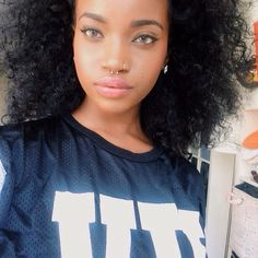 afro and septum piercing