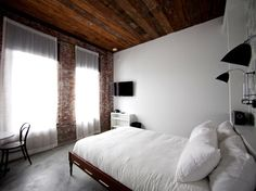The Wythe Hotel in Williamsburg, Brooklyn has stunning views and simple decor. #interiordesign #hotel #architecture