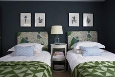 Two framed prints above each single bed - if you click through to the original blog post (photographs from UK House + Garden Nov 2012), you can see how the room was also styled with a mirror in the middle to make the two groups of two into a group of five. Which do you prefer?