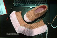 Socklets bootees on two spokes for adults from a thick yarn. Knitting by spokes.