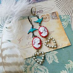 red white cameo earrings, teal blue birds, assemblage, shabby chic jewelry, cottage chic, left right facing, pearl hearts, quirky, colorful
