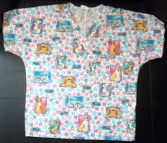 """$15.98/ Unisex Scrub Top features Dogs & Cats theme """"Woof, Ruff, Meow...Purr"""" Vet uniform by SB Unisex Scrubs is size Small ~~see over 20 categories of merchandise in my store. SHIPPING IS ALWAYS FREE in the USA; I do ship globally www.shellyssweetfinds.com"""