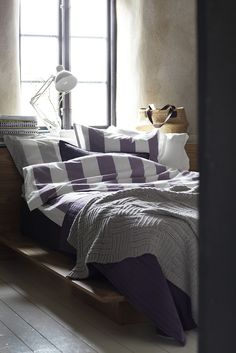 a cozy small room with big windows & a white reading lamp... uhm I approve that