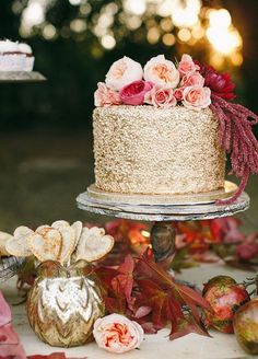 Romance is guaranteed with this wedding cake full of glitters with gold tinted frosting!