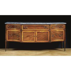 An attractive and large two-toned mahogany sideboard, probably French<br>in Georgian Style, late 18th century | lot | Sotheby's