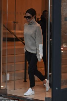 Dressed down: The mother-of-four wore a beige and cream knitted jumper with a high neck fo...